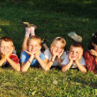 Stock Photo: Happy beautiful children laying on ground outdoor