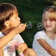 Stock Photo: Happy cute children playing with bubbles