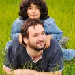 Young father and little cute girl, happiness on meadow — Stock Photo