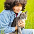Very cute little girl with cat on meadow — Foto Stock
