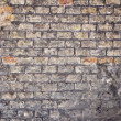 An old and characteristic wall, colorful brickwall — Foto Stock
