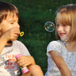 Stock Photo: Happy childhood in summer outdoor, with bubbles