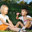 Happy childhood in summer outdoor, with bubbles — Stock Photo