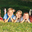 Children together, happiness on green meadow in summer time — Stock Photo