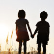 Two children, sunset, romantic scene — Stock Photo