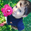 Very cute little boy with rose outdoor, closeup - Stock Photo