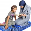 Young nice muslim female teaching her daughter — Stock Photo