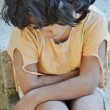 Poverty and poorness on the expression of children - Stockfoto