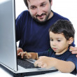 Father and son on laptop — 图库照片