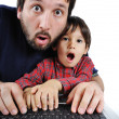 Father and son on laptop, shock — Stok fotoğraf