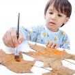 Stock Photo: Kid painting on leafs