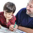 Cute child is painting and playing with his father — Stock Photo