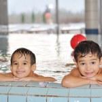 Children playing on beautiful pool — Stock Photo