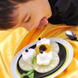 Kid eating dessert — Stock Photo