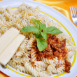 Italian macaroni with original ingredients, on golden fabric — Stock Photo