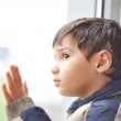 A kid on the window waiting — Stock Photo #9992834