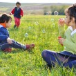 Stock Photo: Playing with bubbles on meadow
