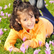 Girl on meadow with pink flowers arond — Stock Photo