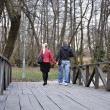 Couple in the park walking - Stockfoto
