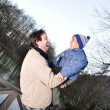 Stock Photo: Father and son in park, fall scene