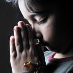 Girl praying in the dark — Stock Photo