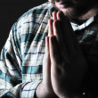 Man praying in the dark — Stock Photo