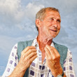 Middle aged poor male person with interesting gestures - Stock Photo