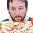 Adult person with surprised face on pizza table — Stock Photo #9993315