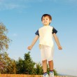 Very cute kid in beautiful clothes on outdoor scene — Stock Photo
