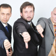 Group of young businessmen together on light background — Stock Photo