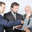 Three young businessmen on laptop — Stock Photo