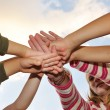 Small group of happy children outdoor, their hands crossed — Stockfoto