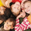 Stock Photo: Small group of happy children outdoor