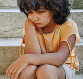 Poverty and poorness on the expression of children — Stock Photo