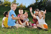 Happy beautiful children playing on ground outdoor — Stock Photo