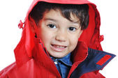 Cute kid in red jacket — Stock Photo