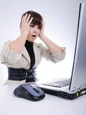 Shocked woman on laptop — Stock Photo