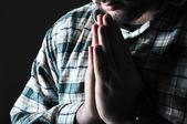 Man praying in the dark — Stock Photo