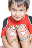 Cute kid with painting on legs — Stock Photo