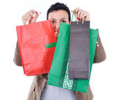 Modern woman shopping in mall holding bags — Stock Photo