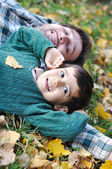 Father and son on ground — Stock Photo