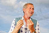 Middle aged poor male person with interesting gestures — Stock Photo