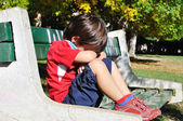 Sad child in the park, outdoor, summer to fall — Foto Stock