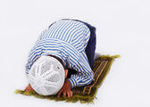 Little muslim boy is praying on traditional way — Stock Photo
