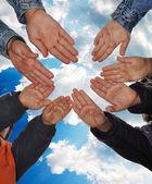 Many little children hands agains blue sky — Stock Photo