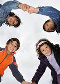 Four young children holding hands — Stock Photo