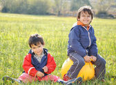 Happy childhood on green beautiful meadow — Stock Photo