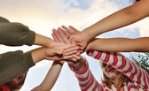 Small group of happy children outdoor, their hands crossed — Stock Photo