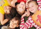 Small group of happy children outdoor — Stock Photo