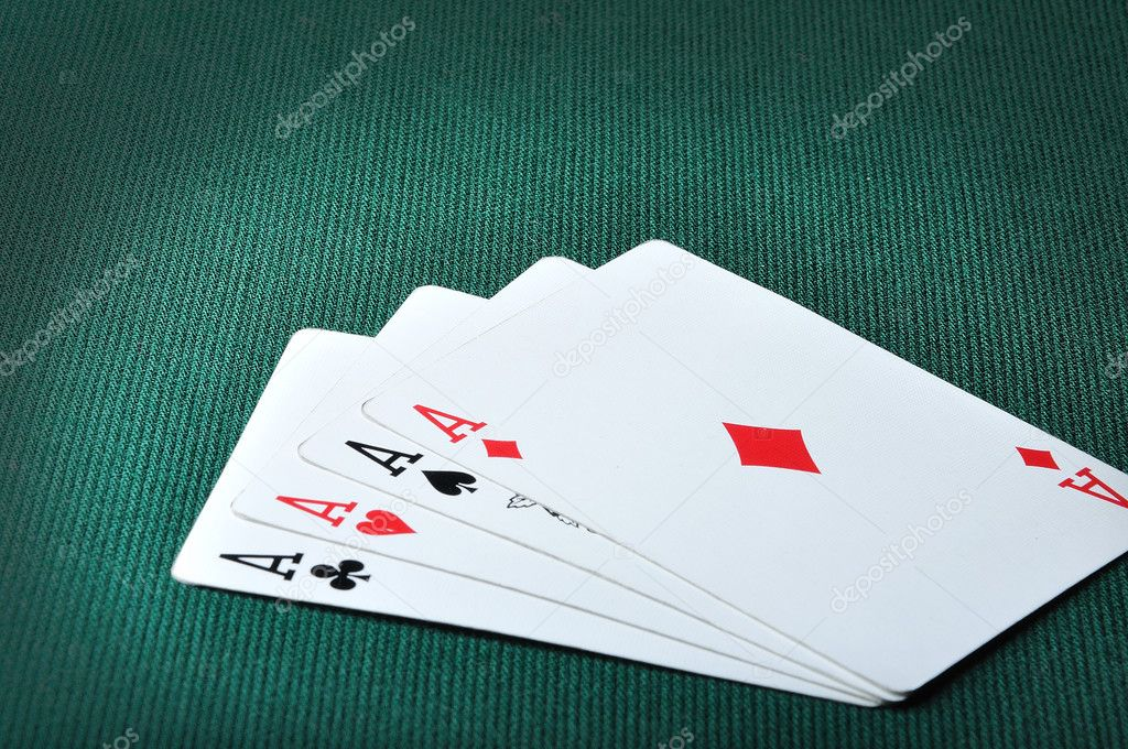 Four aces in casino on green background — Stock Photo #9992892
